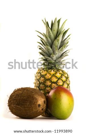 Tropical Trio - Pineapple, Mango and Coconut - stock photo