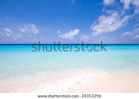 tropical turquoise sea landscape with clouds at horizon - stock photo