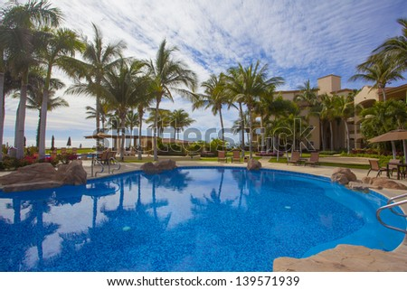 Tropical vacation pool - stock photo