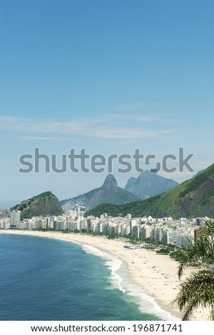 Tropical view of Copacabana Beach with city skyline of Rio de Janeiro Brazil aerial view - stock photo