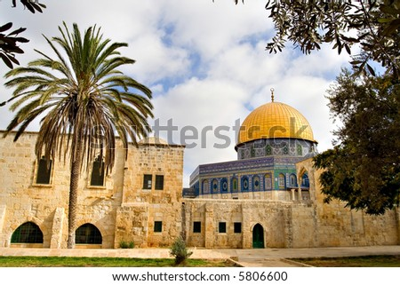 Tropical view of the Golden Dome Mosque, with palm and olive treest (Jerusalem, Israel) - stock photo