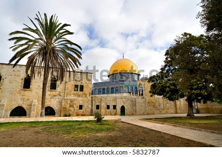 Tropical view of the Golden Dome Mosque with palm tree (Jerusalem, Israel) - stock photo