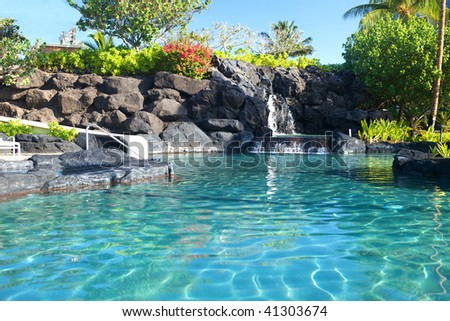 Tropical waterfall landscape in a beautiful relaxing spa resort, copy space - stock photo