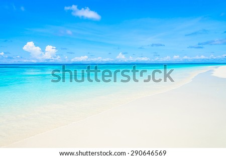 Tropical wave sea on the beach on blue sky background