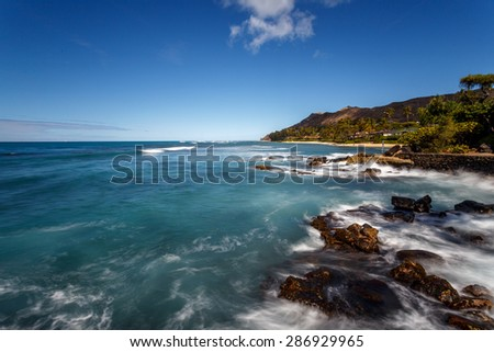 Tropical white sand beaches, blue water, blue skies and palm trees in, Oahu, Hawaii - stock photo