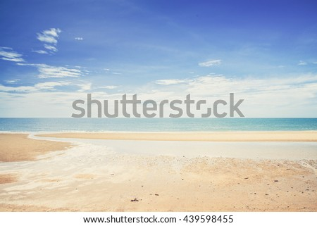 Tropical white sandy beach at sunny day. (Vintage filter effect used) - stock photo