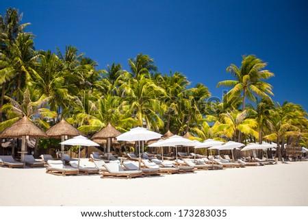 Tropical white sunny beach in beautiful exotic resort - stock photo