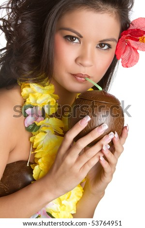 Tropical woman drinking from coconut - stock photo