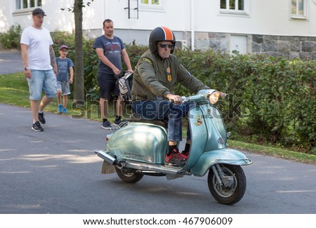 TROSA SWEDEN July 7, 2016 Elderly man driving a Lambretta in the small idyllic town of Trosa in Sweden.