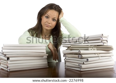 trouble woman in the office with heap of files - stock photo