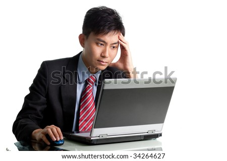 Troubled Asian Chinese/Japanese businessman having a bad day or bad migraine - stock photo