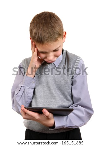 Troubled Boy with Tablet Computer Isolated on the White Background - stock photo