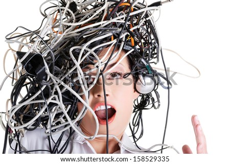Troubled shocked businesswoman with cables on head  - stock photo