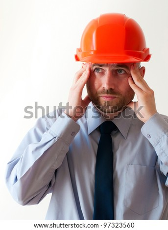 troubled worker in red helmet on white background - stock photo