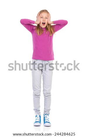 Troubles. Shocked young girl young holding head in hands. - stock photo