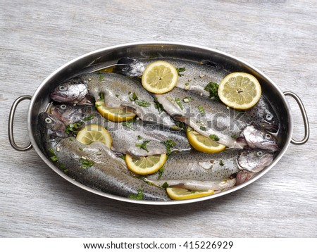 Trout fish prepared for roast - stock photo