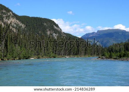 Trout River in Muncho Lake Provincial Park, British Columbia, Canada - stock photo