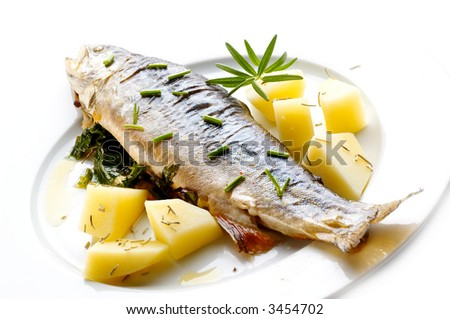 Trout with herbs - stock photo