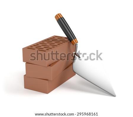 Trowel and bricks on white background - stock photo
