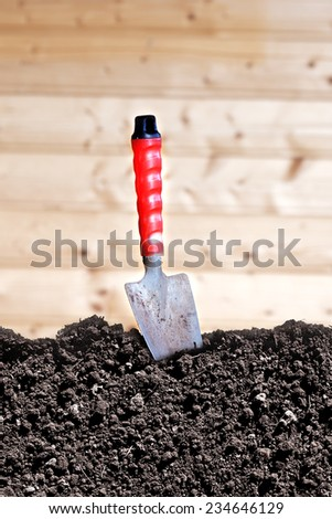 Trowel and soil humus - stock photo