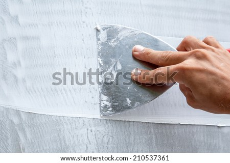 Trowel painting - stock photo