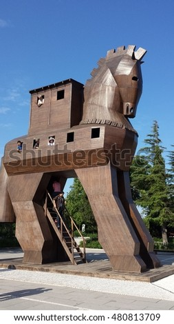 Troy, Turkey - June 10, 2015: Tourists inside the Trojan horse. They look through the windows