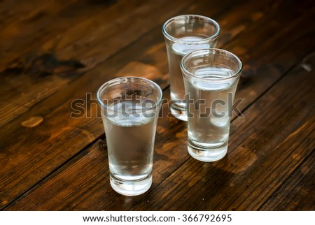 Tru Misted Glasses With Cold Water On An Old Wooden Table
