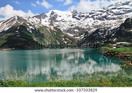 Trubsee lake is among Alps, Engelberg, Switzerland. - stock photo