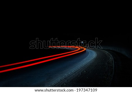 Truck and car light trails in tunnel. Art image . Long exposure photo taken in a tunnel