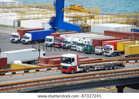 truck and container warehouse near the sea - stock photo