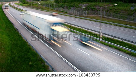 truck at high speed blurred motion on highway - stock photo