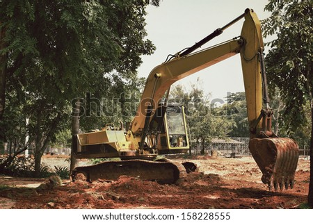Truck backhoe with trees.