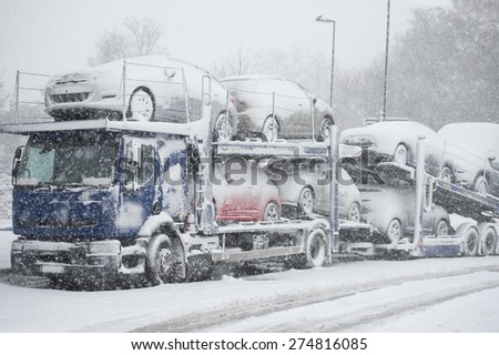 Truck blocked on an highway caused by heavy snowfall - stock photo
