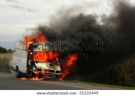 Truck burning creating large flames  and smoke - stock photo