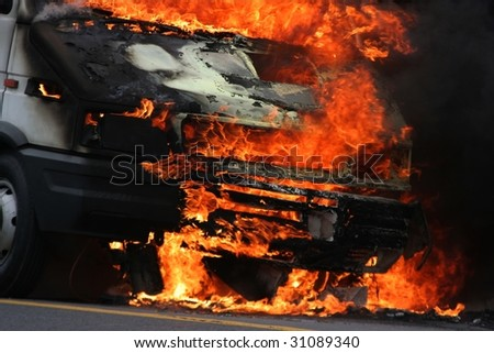 Truck burning making large flames - stock photo