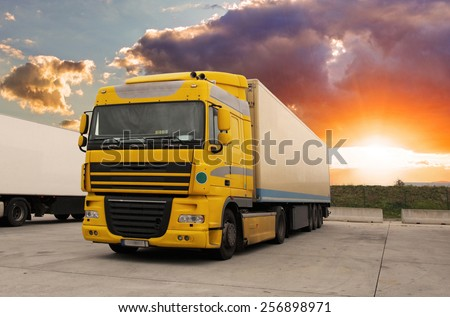 Truck - cargo transportation with sun - stock photo