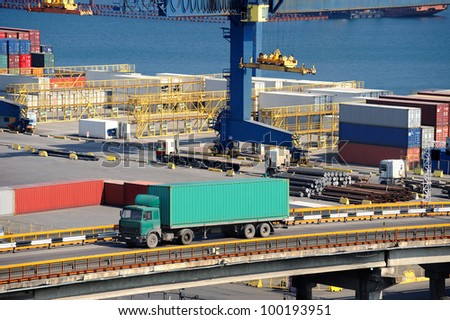 truck carries container. port and sea - stock photo