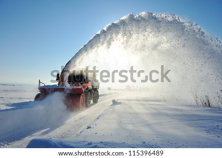 truck cleaning road in winter - stock photo