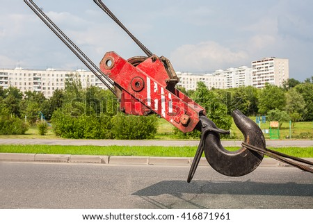 truck crane hook against the new city area - stock photo