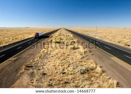 Truck delivery on Arizona I-40 highway across USA - stock photo