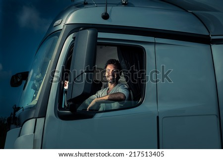 Truck driver sitting in cab