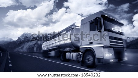 truck driving at dusk/motion blur - stock photo