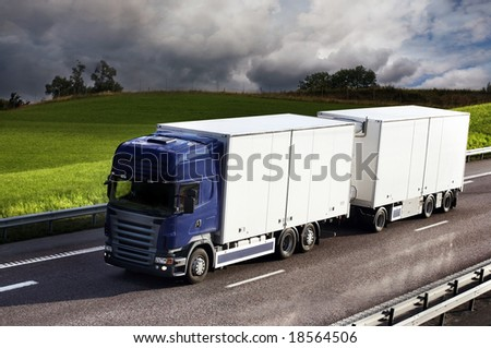 truck driving on country-road - stock photo