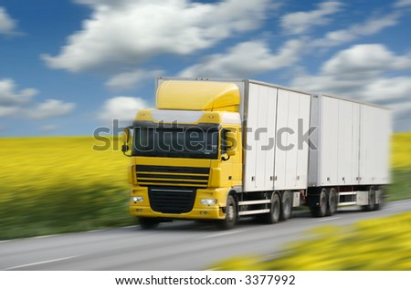 truck driving on country-road/motin blur - stock photo
