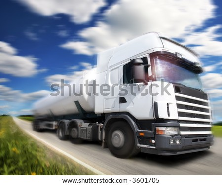truck driving on country-road/motion - stock photo