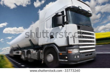 truck driving on country-road/motion blur - stock photo