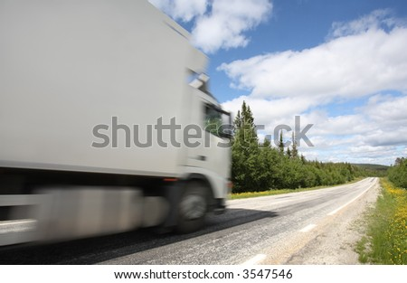 truck driving on country-road/motion blur
