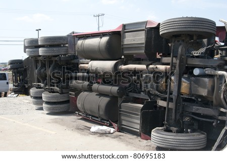 Truck flipped over well trying to avoid a car that pulled out in front of him, - stock photo