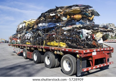 Truck full of wrecked cars for scrap - stock photo