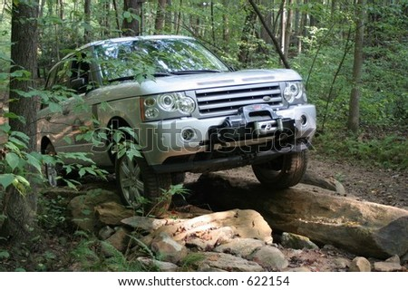 Truck going over rough terrain - stock photo